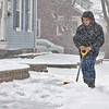 Steven Alejandro, 19, clears the snow off the sidewalk in front of his home on Lincoln Street in Fitchburg during Wednesday's storm. SENTINEL & ENTERPRISE/JOHN LOVE