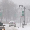 Two pedestrians walk up North Street in Fitchburg during Wednesday's Storm. SENTINEL & ENTERPRISE/JOHN LOVE