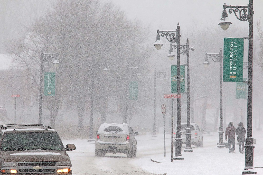 . Two pedestrians walk up North Street in Fitchburg during Wednesday\'s Storm. SENTINEL & ENTERPRISE/JOHN LOVE