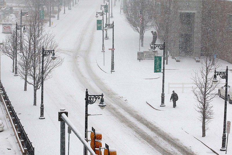 A pedestrian walks up North Street in Fitchburg by the North Street Fire Station during Wednesday's storm. SENTINEL & ENTERPRISE/JOHN LOVE