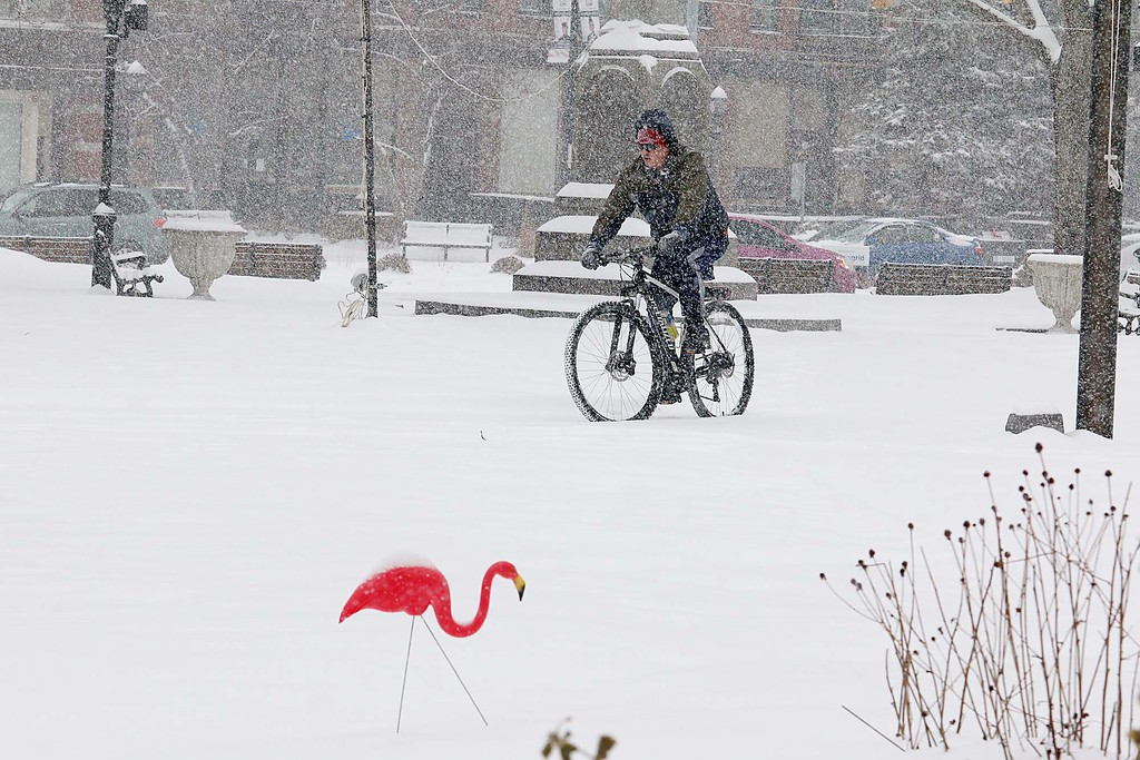 . Leominster resident Kevin Coxen crossed Monument Square on his bike during Wednesday\'s storm. He said he was just out for a ride and had nowhere to really go. SENTINEL & ENTERPRISE/JOHN LOVE