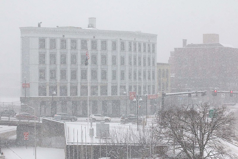 You is hard to see the buildings on Main Street in Fitchburg during Wednesday's storm. SENTINEL & ENTERPRISE/JOHN LOVE