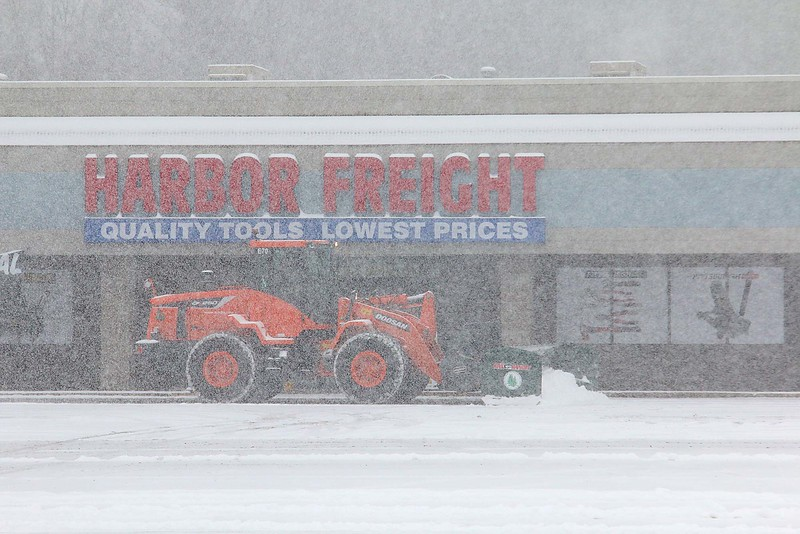 A plow clears snow in the parking lot in front of Harbor Freight on John Fitch Highway during Wednesday's storm. SENTINEL & ENTERPRISE/JOHN LOVE