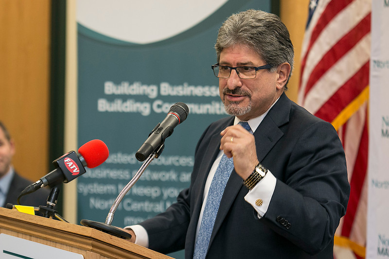 Fitchburg Mayor Stephen DiNatale talks about the North Central Massachusetts Chamber of Commerce's new gift card at their headquarters in Fitchburg on Tuesday afternoon. SENTINEL & ENTERPRISE/JOHN LOVE