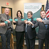Tony Mercadante the Chairman of the Board for North Central MA Chamber of Commerce, Rick Walton Owner of the Gardner Ale House, State Senator Jennifer Flanagan, Fitchburg Mayor Stephen DiNatale, Roy Nascimento the President and CEO for the North Central Massachusetts Chamber of Commerce's and State Rep. Stephan Hay show off the new gift card at the chambers headquarters in Fitchburg on Tuesday afternoon. SENTINEL & ENTERPRISE/JOHN LOVE