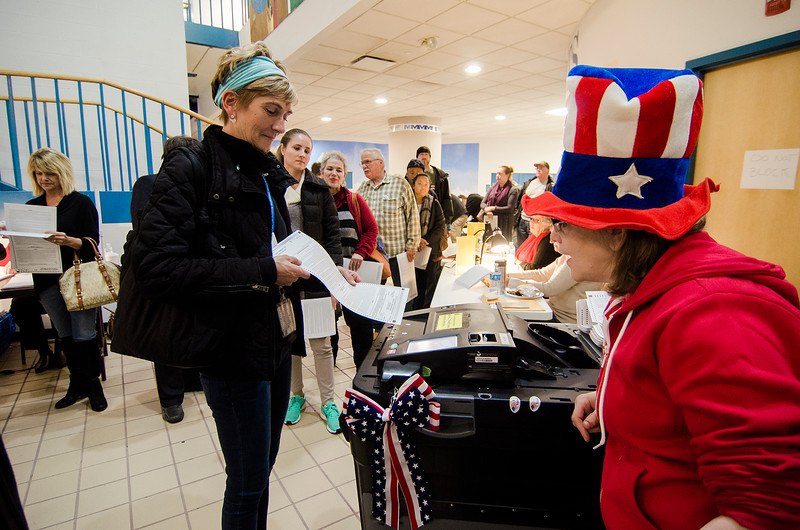 Voters submit their ballots during Election Day at the MART station on Tuesday in Fitchburg. SENTINEL & ENTERPRISE / Ashley Green