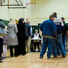 Voters wait in line at Memorial Middle School during Election Day on Tuesday in Fitchburg. SENTINEL & ENTERPRISE / Ashley Green