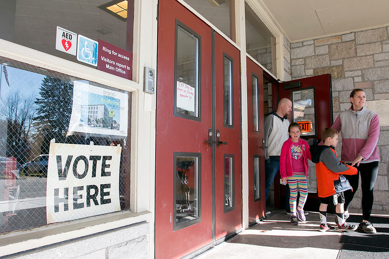 Voters leave the polls in Lunenburg at the old Thomas C. Passios Elementary School. SENTINEL & ENTERPRISE/JOHN LOVE