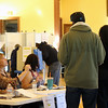 Poll workers give voters directions as they enter the Great Hall in the Ayer Town Hall where voting takes place. Nashoba Valley Voice Photo by David H. Brow.