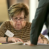 Checking in the early voter ballots at the polls in Leominster City Hall on Tuesday is Irene Greco. SENTINEL & ENTERPRISE/JOHN LOVE