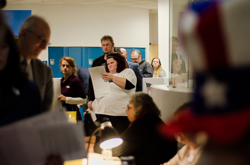 Voters wait in line to submit their ballots during Election Day at the MART station on Tuesday in Fitchburg. SENTINEL & ENTERPRISE / Ashley Green