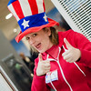 Volunteer Shannon Kessler shows off her during Election Day patriotism at the MART station on Tuesday in Fitchburg. SENTINEL & ENTERPRISE / Ashley Green