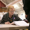 Checking in voters at the polls in the Fitchburg Senior Center is election worker Shirley St. Martin on Tuesday morning. SENTINEL & ENTERPRISE/JOHN LOVE