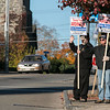 "John Casey the Commander of the American Legion and Bob Haskell the adjutant for the American Legion hold signs for Thomas ""Frank"" Ardinger on West Street in Leominster on Tuesday morning. SENTINEL & ENTERPRISE/JOHN LOVE"