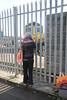 Liz getting a shot of 66 508 through fence on Midland Road
