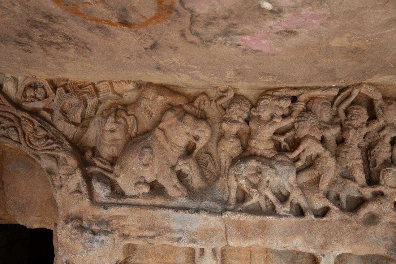 Udaygiri - ancient swastik and a wild elephant and avillage scene