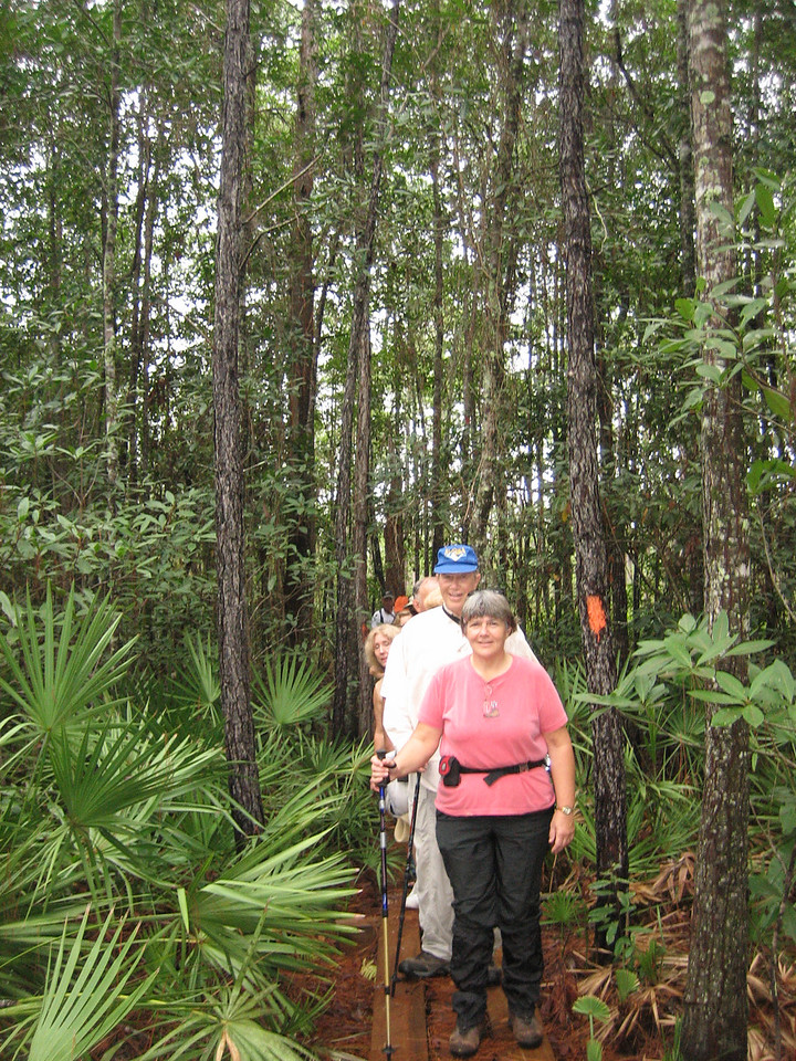Hikers emerging from a bayhead swamp<br /> photo credit: Sandra Friend / Florida Trail Association