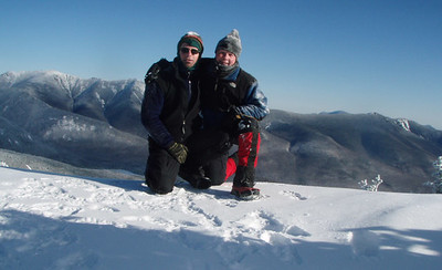 The duo on the viewing ledge below the summit of North Kinsman