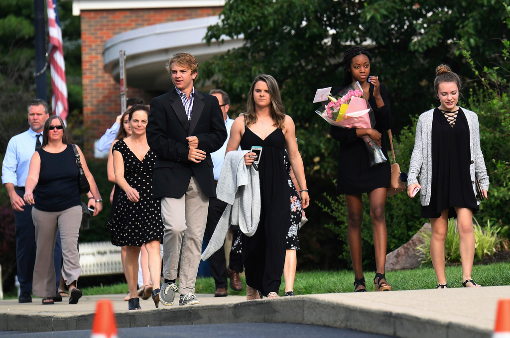 . Mourners arrive for the funeral of Otto Warmbier, Thursday, June 22, 2017, in Wyoming, Ohio. Warmbier, a 22-year-old University of Virginia undergraduate student who was sentenced in March 2016 to 15 years in prison with hard labor in North Korea, died this week, days after returning to the United States. (AP Photo/Bryan Woolston)