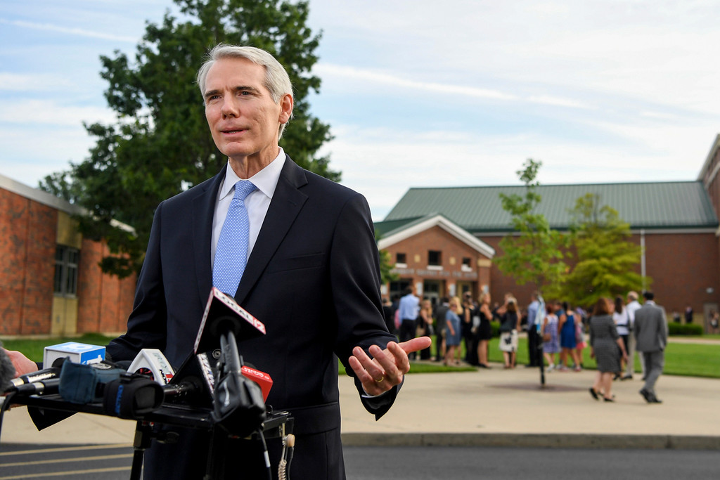 . Sen. Rob Portman, R-Ohio, speaks to the press before the funeral of Otto Warmbier, Thursday, June 22, 2017, in Wyoming, Ohio. Warmbier, a 22-year-old University of Virginia undergraduate student who sentenced in March 2016 to 15 years in prison with hard labor in North Korea, died this week, days after returning to the United States. (AP Photo/Bryan Woolston)
