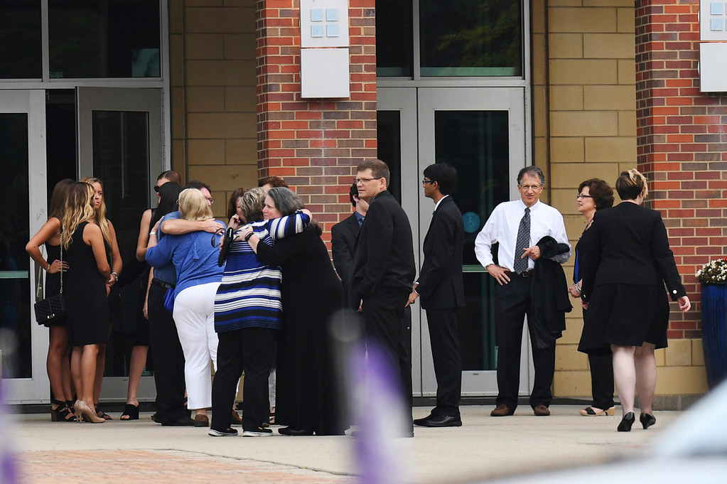 . Mourners arrive for the funeral of Otto Warmbier, Thursday, June 22, 2017, in Wyoming, Ohio. Warmbier, a 22-year-old University of Virginia student who was sentenced in March 2016 to 15 years in prison with hard labor in North Korea, died this week, days after returning to the United States. (AP Photo/Bryan Woolston)