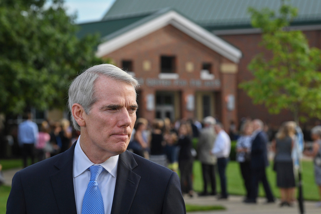 . Sen. Rob Portman, R-Ohio, speaks to the press before the funeral of Otto Warmbier, Thursday, June 22, 2017, in Wyoming, Ohio. Warmbier, a 22-year-old University of Virginia undergraduate student who was sentenced in March 2016 to 15 years in prison with hard labor in North Korea, died this week, days after returning to the United States. (AP Photo/Bryan Woolston)