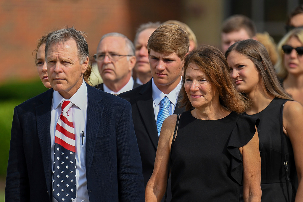 . Fred and Cindy Warmbier watch as their son Otto, is placed in a hearse after his funeral, Thursday, June 22, 2017, in Wyoming, Ohio. Otto Warmbier, a 22-year-old University of Virginia undergraduate student who was sentenced in March 2016 to 15 years in prison with hard labor in North Korea, died this week, days after returning to the United States. (AP Photo/Bryan Woolston)