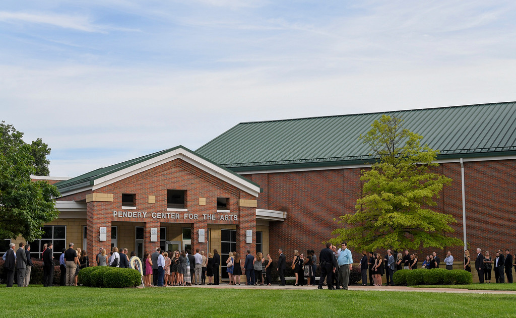 . Mourners line up for the funeral of Otto Warmbier, Thursday, June 22, 2017, in Wyoming, Ohio. Warmbier, a 22-year-old University of Virginia undergraduate student who was sentenced in March 2016 to 15 years in prison with hard labor in North Korea, died this week, days after returning to the United States. (AP Photo/Bryan Woolston)
