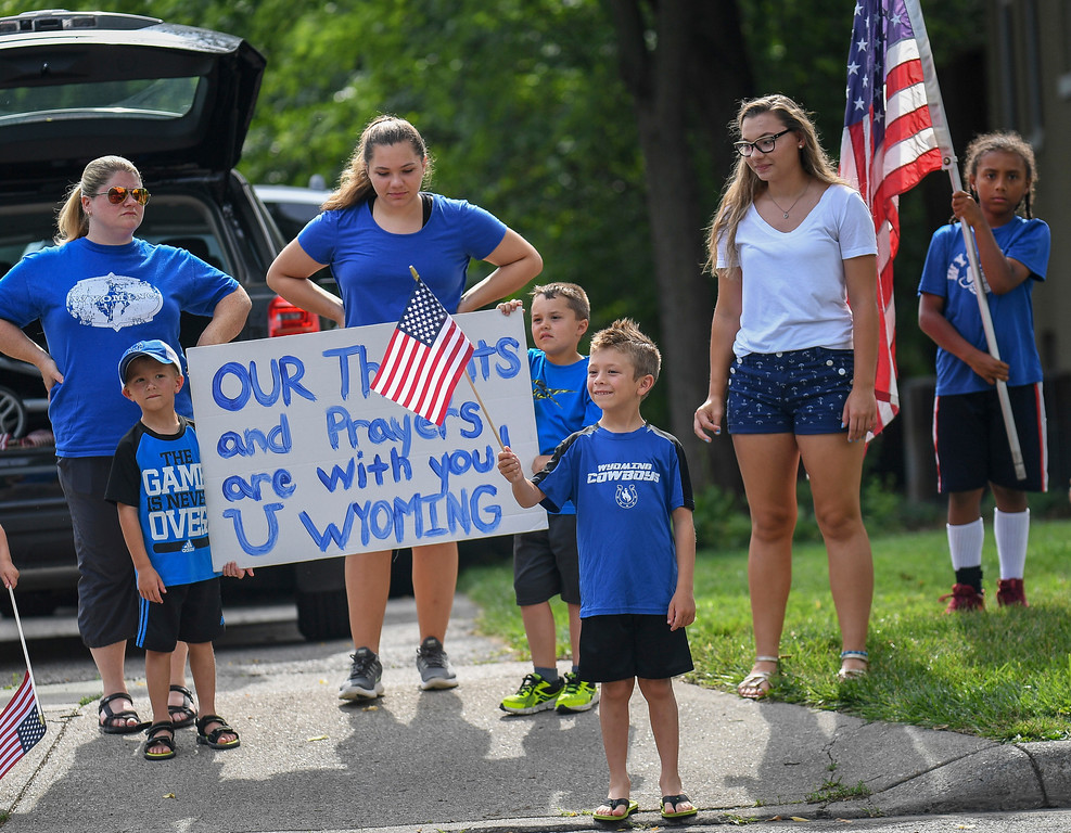 . Mourners line the street after the funeral of Otto Warmbier, Thursday, June 22, 2017, in Wyoming, Ohio. Warmbier, a 22-year-old University of Virginia undergraduate student who was sentenced in March 2016 to 15 years in prison with hard labor in North Korea, died this week, days after returning to the United States. (AP Photo/Bryan Woolston)