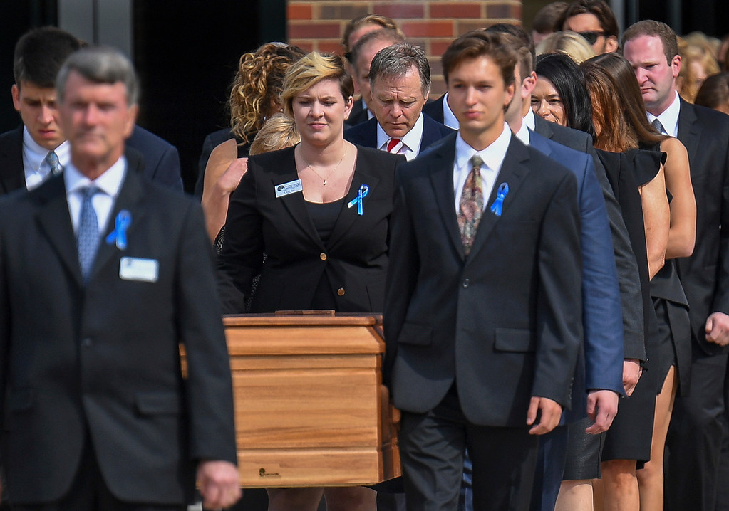 . The casket of Otto Warmbier is carried from Wyoming High School followed by his father, Fred Warmbier, center, after the funeral, Thursday, June 22, 2017, in Wyoming, Ohio. Otto Warmbier, a 22-year-old University of Virginia undergraduate student who was sentenced in March 2016 to 15 years in prison with hard labor in North Korea, died this week, days after returning to the United States. (AP Photo/Bryan Woolston)