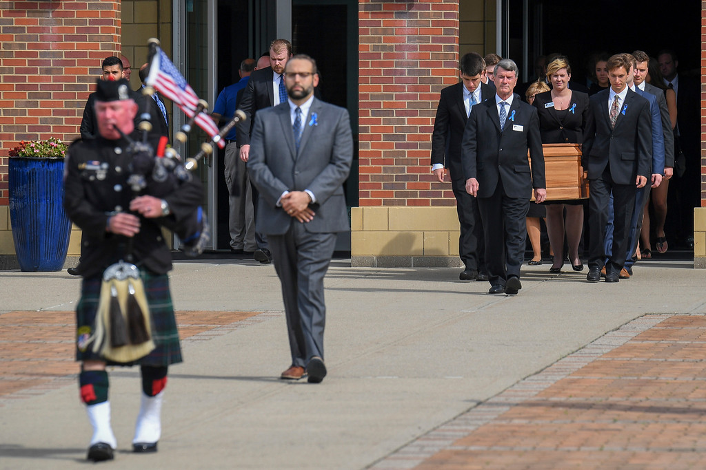. The casket of Otto Warmbier is carried from Wyoming High School after his funeral, Thursday, June 22, 2017, in Wyoming, Ohio. Warmbier, a 22-year-old University of Virginia undergraduate student who was sentenced in March 2016 to 15 years in prison with hard labor in North Korea, died this week, days after returning to the United States. (AP Photo/Bryan Woolston)