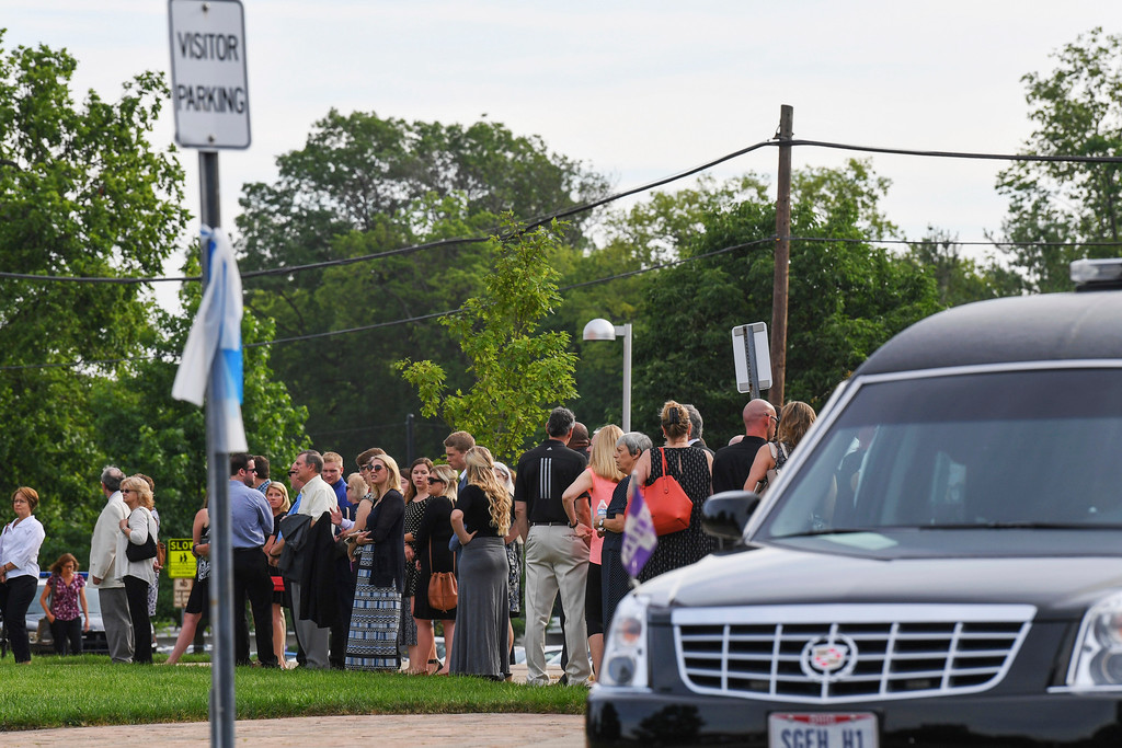 . Mourners line up as they arrive for the funeral of Otto Warmbier, Thursday, June 22, 2017, in Wyoming, Ohio. Warmbier, a 22-year-old University of Virginia undergraduate student who was sentenced in March 2016 to 15 years in prison with hard labor in North Korea, died this week, days after returning to the United States. (AP Photo/Bryan Woolston)