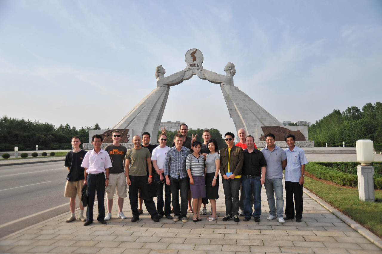 "The North Korean tour group in front of the ""Monument to the Three Charters of National Reunification"""