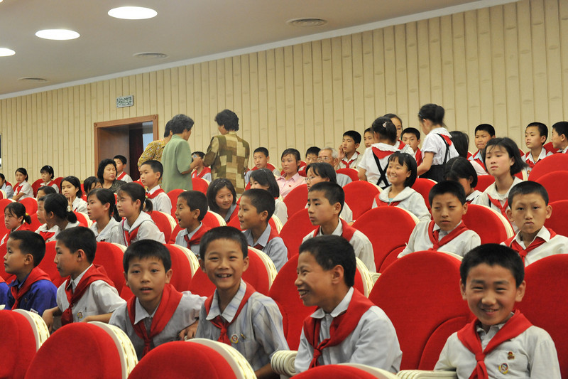 Young pioneers in the Pyongyang Grand Theater.