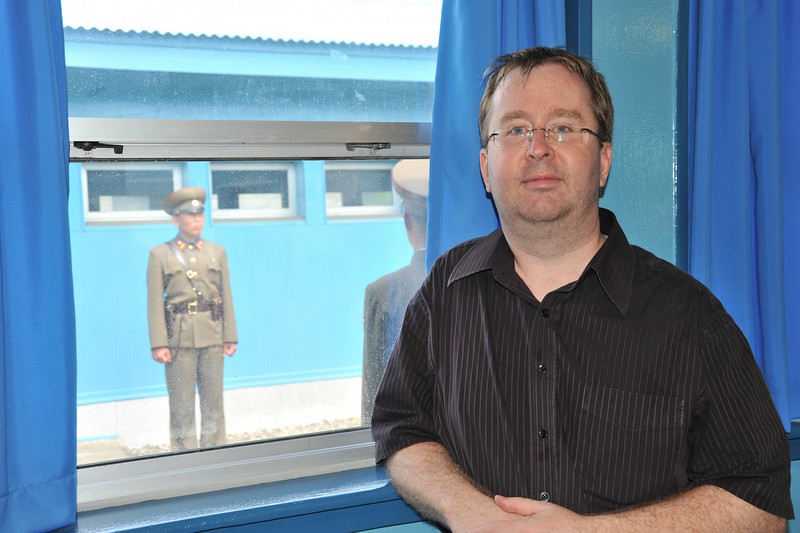 Me on the exact center between North and South Korea, flanked by North Korean military (Inside the UN administered building at the Panmunjom)