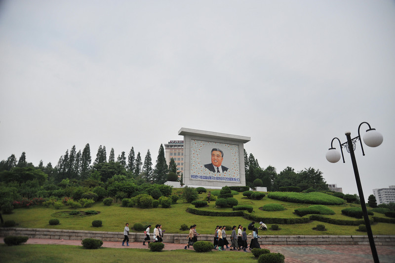 Mural of President Kim Il Sung next to the fountain park.  Murals like this are throughout the country