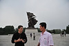 I took this photo at the exact moment that one of our tour members was explaining to our tour guide about the new leader of North Korea.  They receive so little information inside the country that tourists are often a more accurate source of information.  (at the Monument to Victory in the Victorious Fatherland Liberation War)