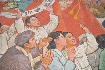 "Detail of the mural outside Kim Il Sung stadium.  This shows how the people are supposed to look up to the ""dear leader"""