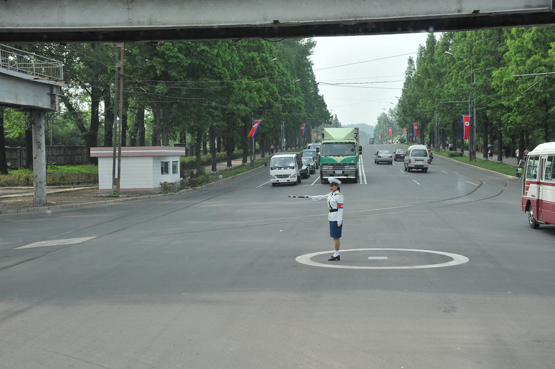 North Korea has so little traffic that they prefer to have female police officers directing traffic - the theory is that the mostly male drivers will pay more attention! (outside the Changwangsan health complex)