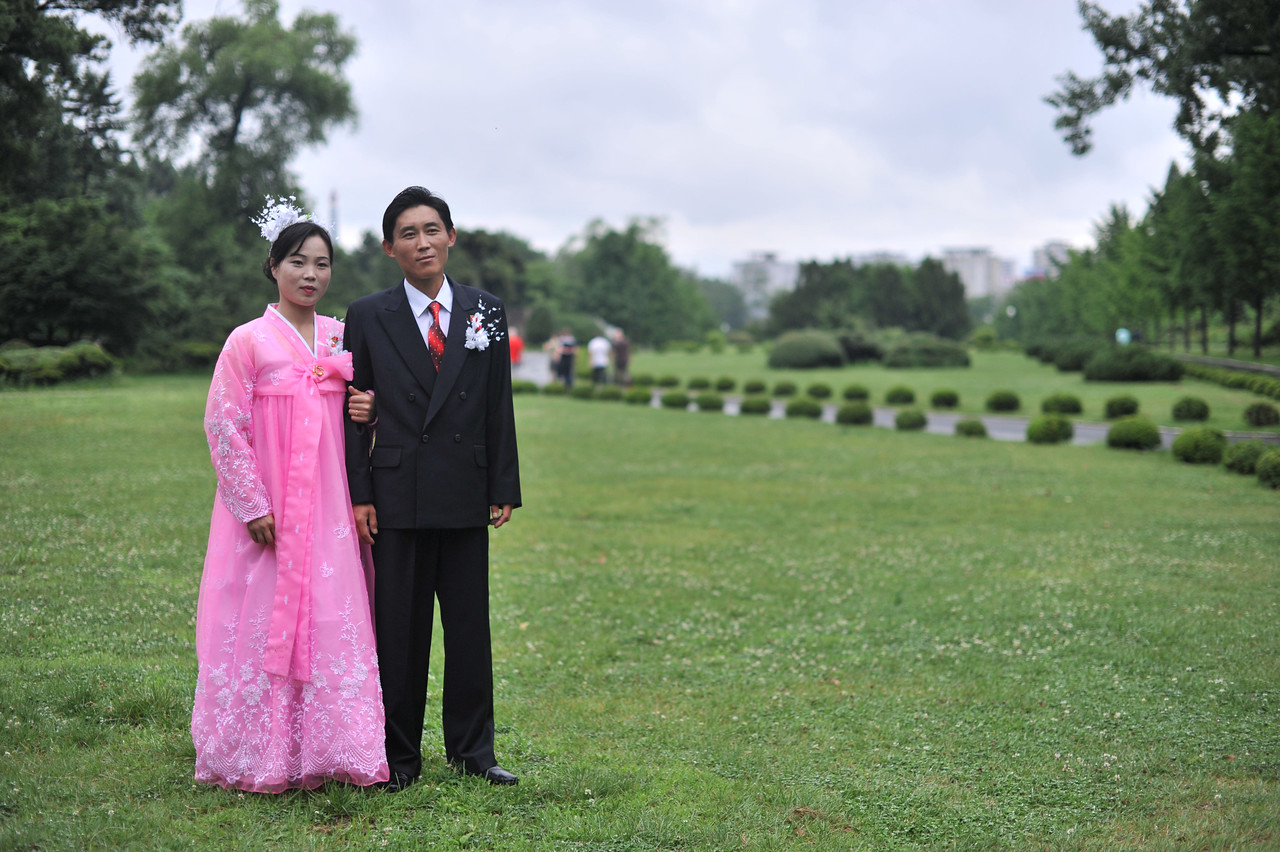 A couple getting married in Moranbong Park.  This is how couples dress on their wedding day in North Korea
