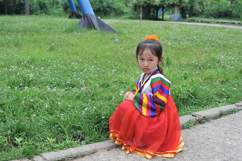 A small child at the Taesongsan fun fair