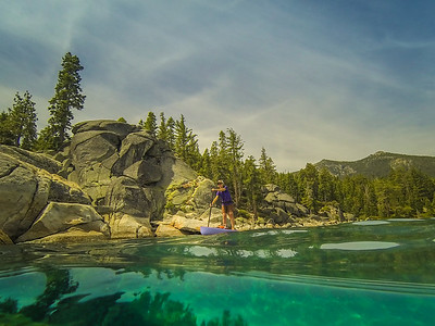 Woman paddleboarding along Bliss State Park in Lake Tahoe