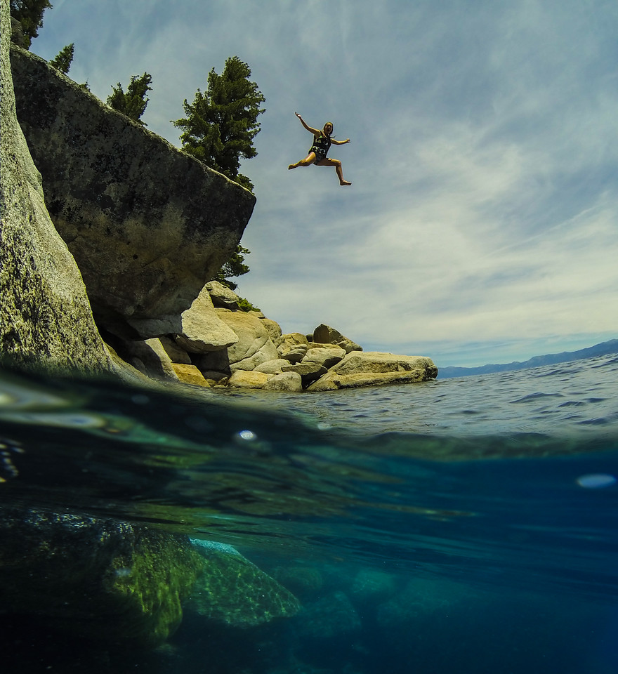 Woman jumpimg into Lake Tahoe Bliss State Park