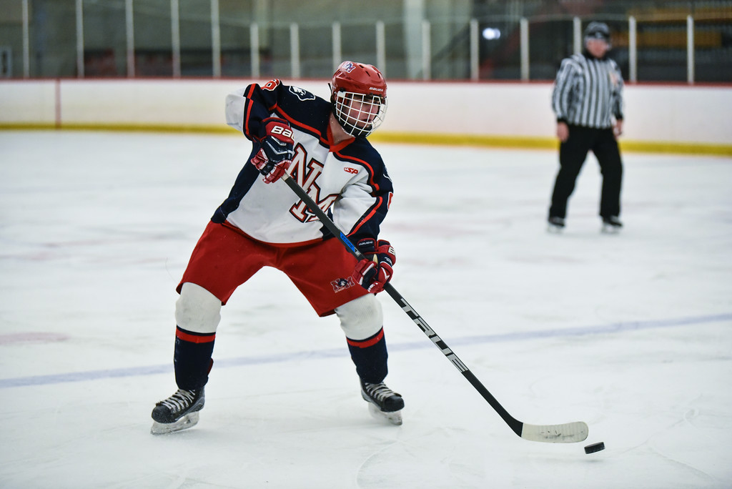 . (02/12/18 GROTON MA) Matt Metras of North Middlesex fires the puck back into the zone in Monday\'s game at home against Algonquin.  SENTINEL & ENTERPRISE JEFF PORTER