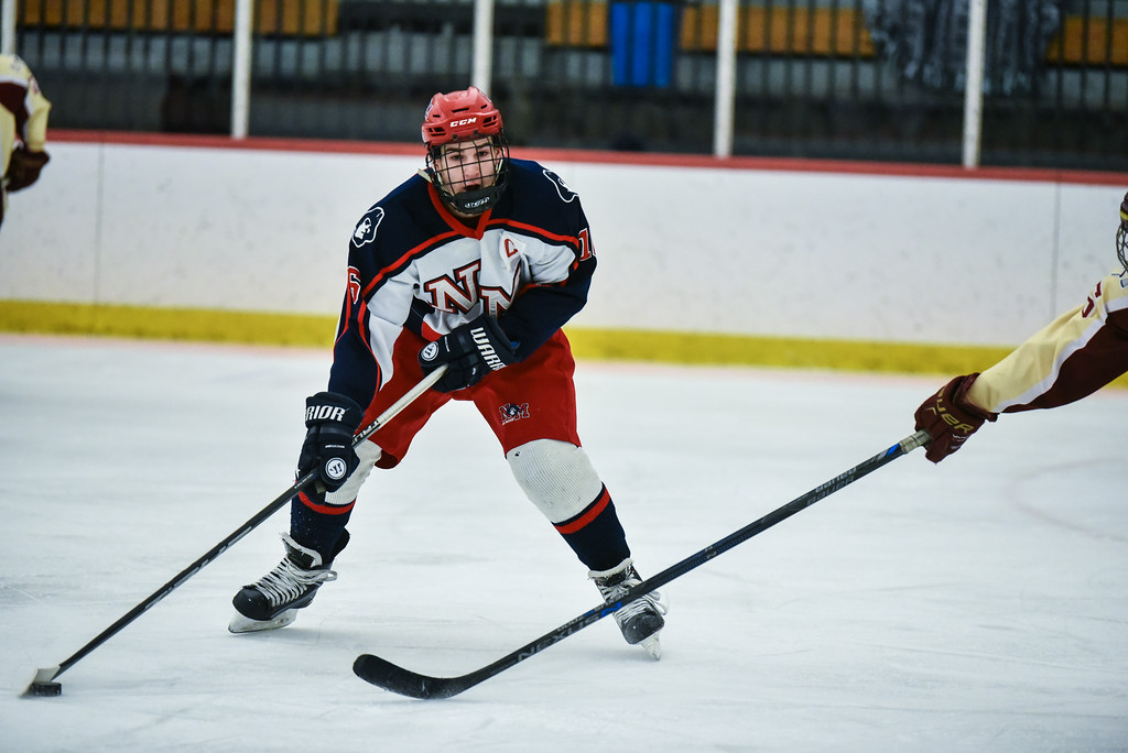 . (02/12/18 GROTON MA) Matt Devito of North Middlesex carries the puck above the circle\'s in his offensive end in Monday\'s game at home against Algonquin.  SENTINEL & ENTERPRISE JEFF PORTER