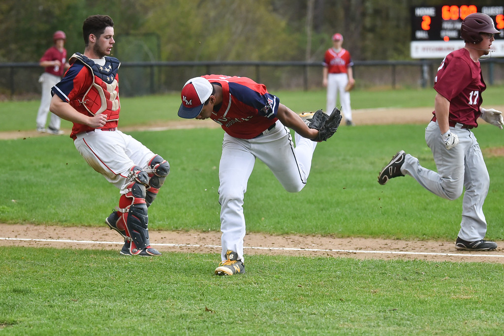 . North Middlesex pitcher Brenden Sullivan rushes to the first base line before the ball goes foul during Monday\'s varsity baseball match up between Fitchburg and North Middlesex at Fitchburg High School.  SUN/JEFF PORTER