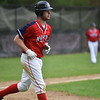 Pat Aubuchon of North Middlesex is walked to first during Monday's varsity baseball match up between Fitchburg and North Middlesex at Fitchburg High School.  SUN/JEFF PORTER
