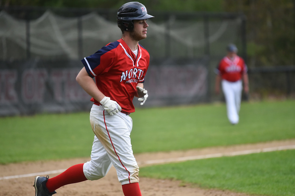 . Pat Aubuchon of North Middlesex is walked to first during Monday\'s varsity baseball match up between Fitchburg and North Middlesex at Fitchburg High School.  SUN/JEFF PORTER