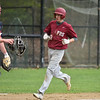 Sage Bray of Fitchburg runs through home during Monday's varsity baseball match up between Fitchburg and North Middlesex at Fitchburg High School.  SENTINEL & ENTERPRISE JEFF PORTER