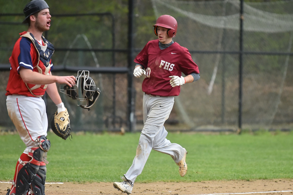 . Sage Bray of Fitchburg runs through home during Monday\'s varsity baseball match up between Fitchburg and North Middlesex at Fitchburg High School.  SENTINEL & ENTERPRISE JEFF PORTER